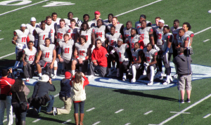 Jaguar seniors pose at midfield with head coach Joey Jones prior to their final home game against Navy.