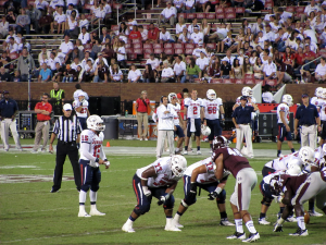 C.J. Bennett reads the defense while head coach Joey Jones looks on from the sidelines in Starkville Mississippi on September 22, 2012. The Bulldogs would win the game 30-10.