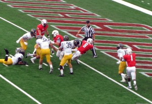 Running back Jay Jones diving in for a Jaguar touchdown against Kent State in 2013.