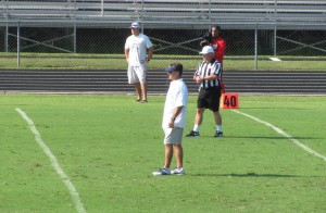 Head coach Joey Jones observes the Jaguars scrimmage on Saturday, August 15 2014 at St. Paul's Episcopal School.