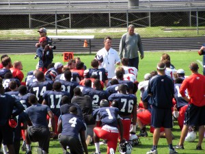 Head coach Joey Jones speaks to his team after their first scrimmage of preseason camp at St. Paul's Episcopal School on Saturday, August 15, 2014.