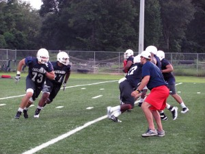 Shaun Artz (73) and Melvin Meggs (77) practice run blocking during the preseason camp in 2012. Meggs will miss the 2013 season with a torn ACL.