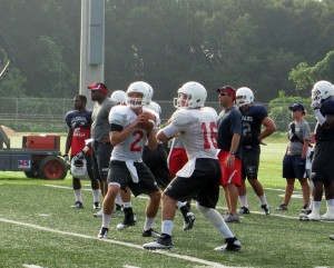 Quarterbacks Trey Fetner and Ross Metheny participating in position drills in a previous seasons practice session.